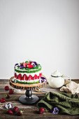 Spinach cake with strawberry cream filling