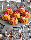 Spicy mini Bundt cakes with beetroot sprouts and goat's cheese