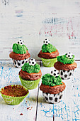 Chocolate muffins with green frosting (football evening)