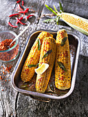 Grilled corn cobs with butter, chilli and fresh sage