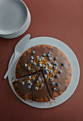 chocolate cake with blueberries and orange zest