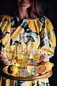 Woman serving homemade Limoncello