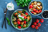 Potato salad with tomatoes and black olives