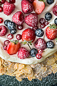 Almond meringue cake with fresh berries (close-up)