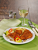Oven-baked breaded escalope with sauerkraut