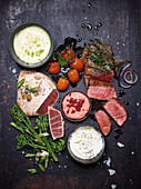 Grilled vegetables, beef steak and tuna with mayonnaise dips
