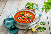 Spicy mexican coen and pepper soup with lime and coriander