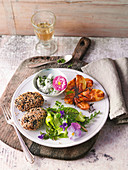 Carrot and spelt patties with herb quark and potatoes