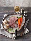 Roasted cabrito with caramelized garden carrots
