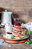 Pancakes with cream cheese and cherries