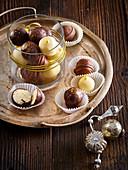 Coconut balls in chocolate