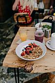 Yoghurt with granola, strawberries, raspberries and blueberries