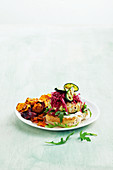 Low-cal chicken burgers with sweet potato and beetroot chips