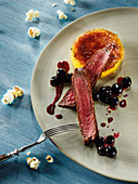 Venison rump with blueberries and sweetcorn crème brûlée made in a beefer