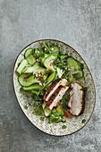 Crispy pork belly on a salad of Spreewald gherkins