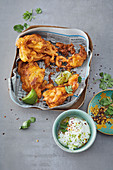 Curry and chilli onion bhajis with a lime and yoghurt dip
