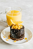 Chocolate cake with orange candied fruit and juice