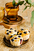 Ricotta muffins with blueberry and orange candied fruit