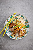 Hangzhou duck confit with egg-fried rice and vegetable ribbons
