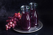 Red grape juice in a glass carafes