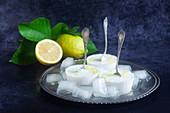 Homemade lemon sorbet on a silver platter