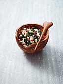 Warm kale salad with root vegetables, feta cheese and pomegranate