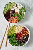 A poke bowl with salmon, and a Buddha bowl with hemp seeds