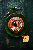 A lemon Bundt cake decorated with butter biscuits and candy canes
