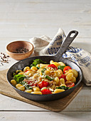 Gnocchi with spinach and tomatoes