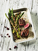 Petit tender made in a Beefer with green asparagus and amaranth crumbles