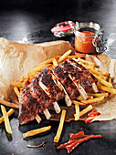 Spare ribs made in a Beefer with a pineapple and barbecue sauce and chips