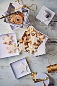 Snowflake-shaped butter biscuits in a gift box