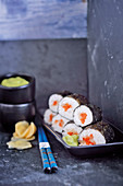 Vegan maki sushi with an avocado and wasabi dip, and gari