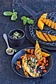 Grilled mango on fried sweet potatoes with basil oil