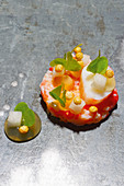 Red king crab with pear blossom and wood sorrel