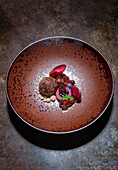 Chocolate balls with macerated fruit and wild sour cherry sorbet