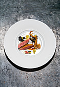 Pigeon with variations of celery and black garlic