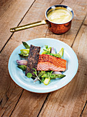 Salmon fillet made in a Beefer with an asparagus and shallot salad