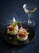 Canapes with prosciutto and pear