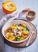Homemade pumpkin gnocchi with vegetables