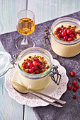 Pudding with rum cranberries and gingerbread crumble