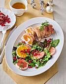 Turkey roll with citrus fruits and pomegranate