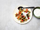 Oriental aubergine and turmeric salad with garlic yoghurt