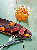 US hanging tender medallions made in a Beefer with pickled pumpkin