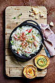 Rhubarb risotto with courgette tartlets
