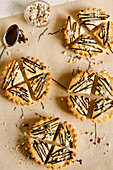 Almond shortbread cookies drizzled with dark chocolate