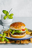 Blue cheese and basil beef burger with mustard barbecue sauce