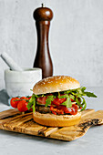 Spicy beef burger with arugula and white sesame bun