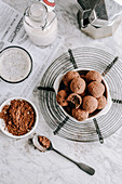 Vegan date and nut truffles dipped in cocoa