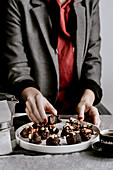 Vegan date truffles in dark chocolate with almonds